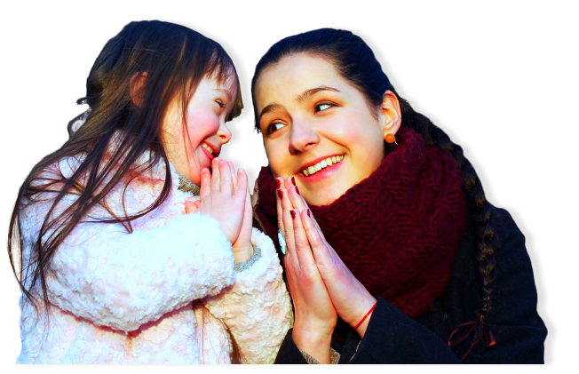 woman and young girl smiling together